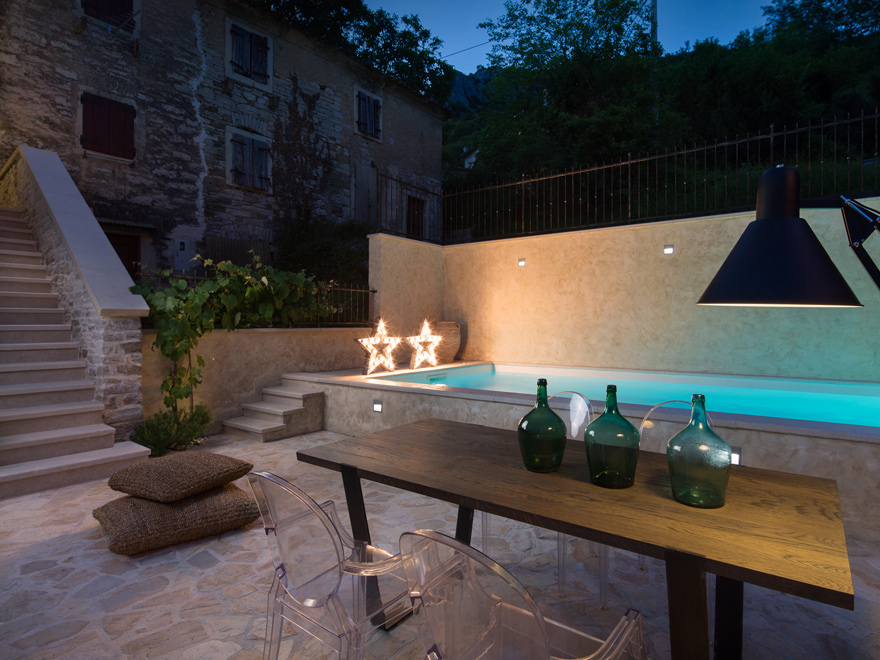 stone house with pool
